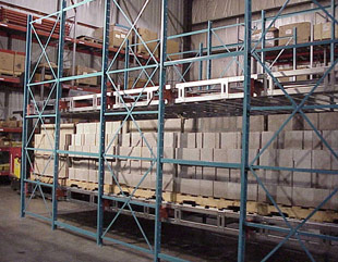 Modular roll back pallet rack