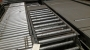 Used Intelligrated 24 x 74 belt over roller BOR conveyor end bed
